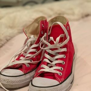 Red high top Converse sneakers